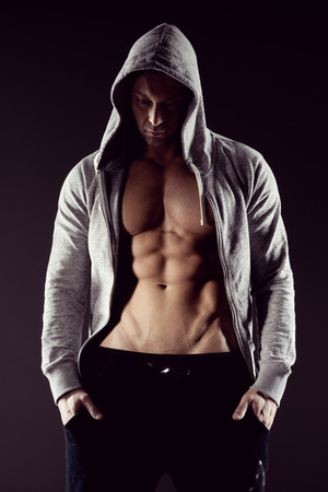 young sex: Body builder in hooded shirt with bare chest.