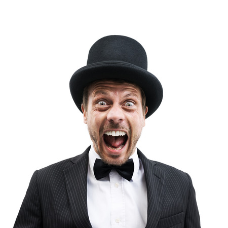 Vintage gentleman with bowler hat and bow tie screaming at camera. photo