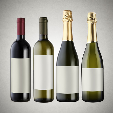 Set of wine bottles on gray background with blank labels. photo