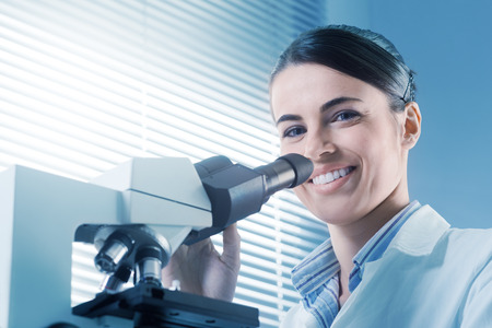 Young female researcher working in the chemistry laboratory. photo
