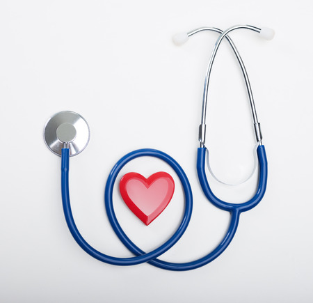Blue stethoscope and heart shape, cardiovascular diseases and prevention concept. photo