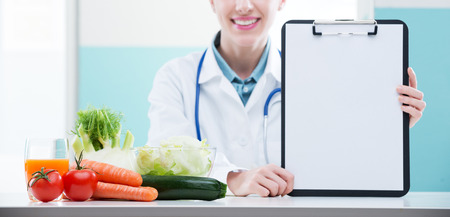 Cheerful healthcare professional promoting healthy eating photo
