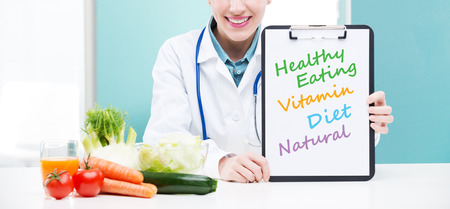 promoting: A portrait of cheerful healthcare professional promoting healthy eating