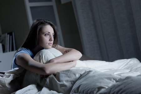 insomnia: Portrait of a young woman suffering from insomnia Stock Photo