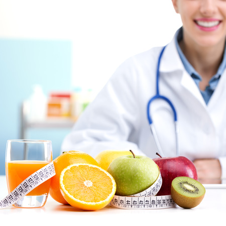 healthy eating: Healthcare professional promoting healthy eating, focus on fruit Stock Photo