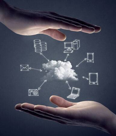 Hand drawn technology and computer icons around cloud with hands on gray background, cloud computing concept. photo