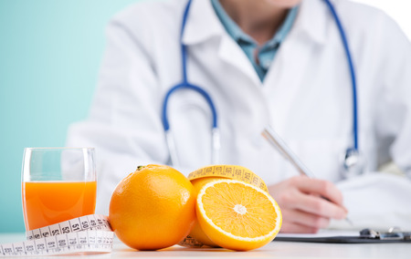 doctor writing: Nutritionist Doctor is writing a diet plan, focus on orange