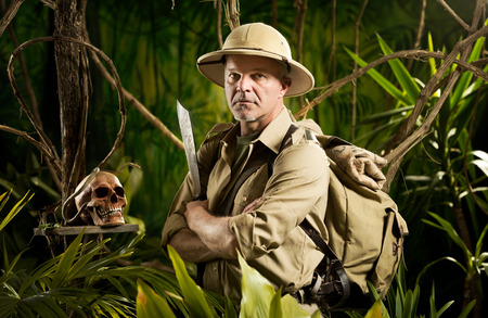 machete: Adventurer with colonial style survival equipment in the jungle with skull.