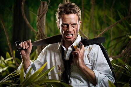 machete: Confident strong businessman dealing with jungle dangers, holding a machete.