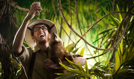 Explorer taking a self portrait with a ferocious animal in the jungle. photo