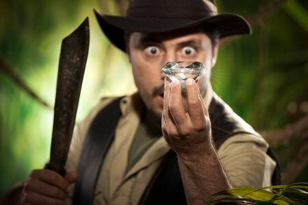 machete: Surprised young explorer finding a huge precious diamond in the jungle.