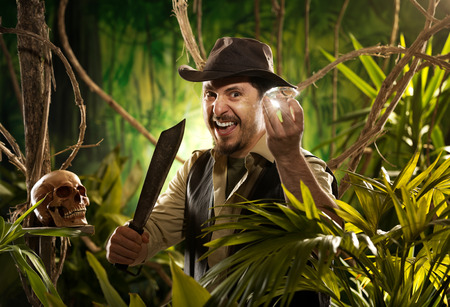 machete: Adventurer with machete finding a huge gem in the jungle with skull on foreground.