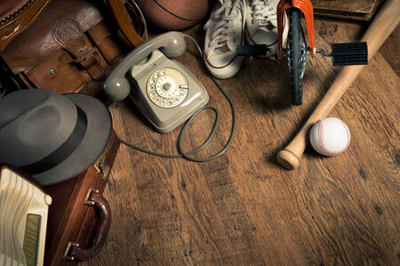secondhand: Group of assorted vintage items on hardwood floor at flea market. Stock Photo