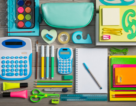 perfectly: Colorful stationery perfectly tidy on wooden surface flooring. Stock Photo
