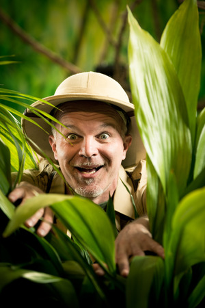 gasping: Surprised adventurer gasping and peeking through plants in the jungle.