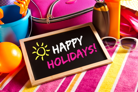 Happy summer holidays card with colorful text on blackboard. photo