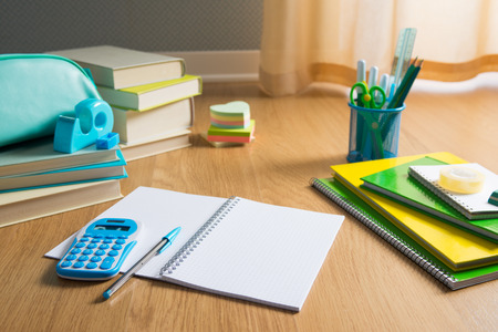pen holder: Colorful stationery on hardwood floor, school and learning concept. Stock Photo