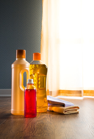 disinfecting: Detergent products for hardwood floor care and manteinance on parquet. Stock Photo