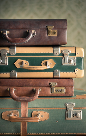 Stack of colorful vintage suitcases, handles close up, travelling concept. photo