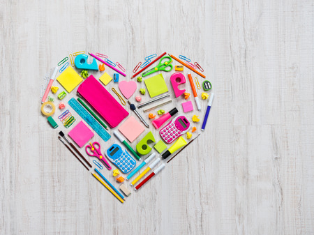 Colorful heart shape composed of stationery and office objects. photo