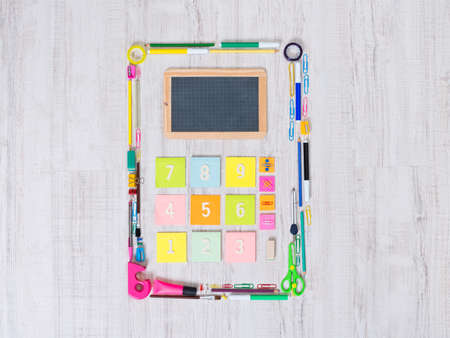 back view student: Colorful calculator composed of assorted stationery objects and stick notes.