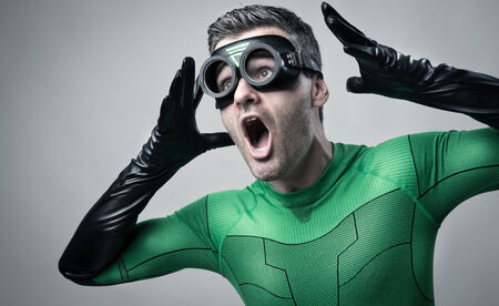 Cool terrified superhero shouting out loud with arms raised. photo