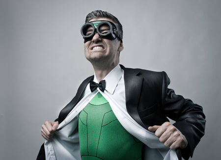 alter ego: Elegant superhero taking off shirt and jacket and showing green costume underneath.