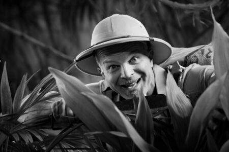 machete: Survival confident adventurer exploring the rainforest jungle holding a machete.