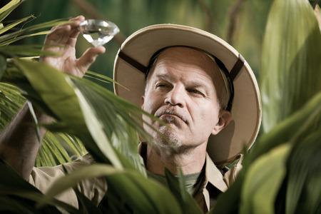 Explorer finding a huge precious gem in jungle wilderness.