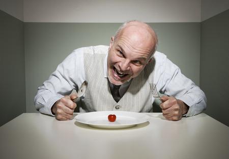 insane: Vintage style insane man having a sad dinner alone.