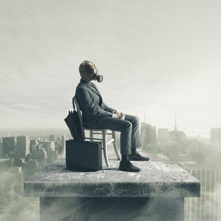 A businessman wearing a gas mask, enjoying a sunny day photo