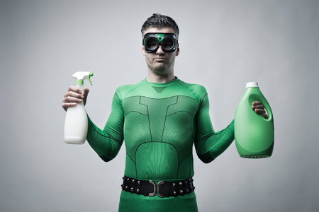 comparisons: Green superhero showing spray detergent and laundry detergent.