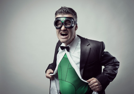 formal shirt: Elegant superhero taking off shirt and jacket and showing green costume underneath.