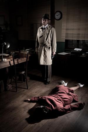 Killer with gun next to a dead woman body lying on the floor, film noir scene.