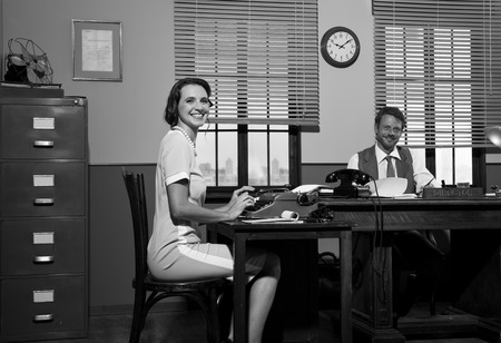 black secretary: Smiling director and secretary working in the office and smiling at camera. Stock Photo