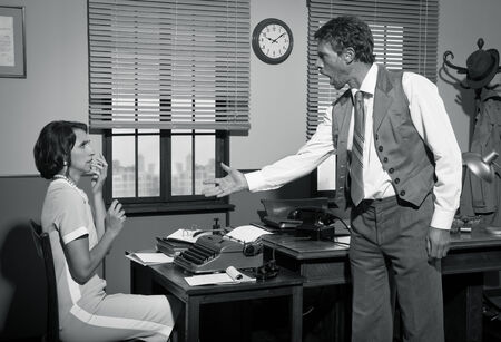 people arguing: Furious director arguing with young secretary, 1950s vintage office.