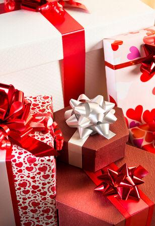 Plenty of elegant christmas gifts on hardwood floor in white..
