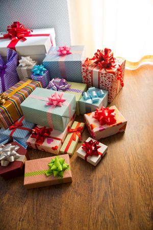 beautifully wrapped: Group of beautifully wrapped gift boxes on the floor for christmas and celebration events.