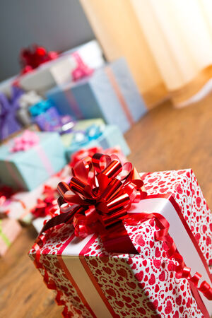 beautifully wrapped: Beautifully wrapped gift close-up with more presents on background.