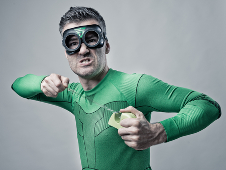 crime fighter: Funny superhero with scotch tape and aggressive expression.