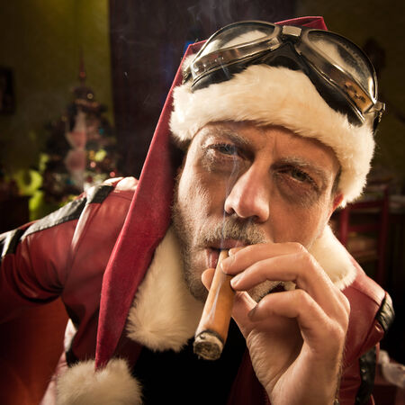 cigar smoke: Portrait of Bad Santa smoking a cigar