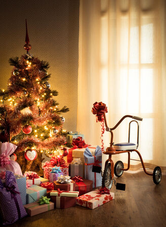 tricycle: Vintage christmas with decorated tree, gifts and retro tricycle. Stock Photo