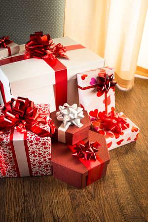 Plenty Of Elegant Christmas Gifts On Hardwood Floor In White.. Stock ...