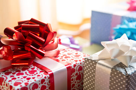 Elegant colorful gift boxes with huge ribbon close-up on the floor. photo