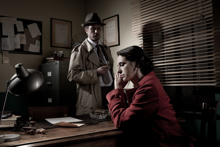 Detective interviewing a young sad woman in his office, film noir scene.