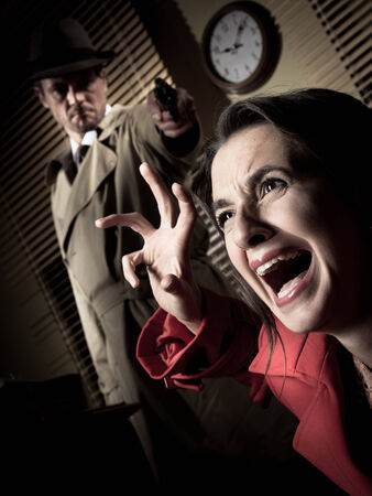 violence in the workplace: Detective standing in the dark and pointing a gun to a screaming woman.