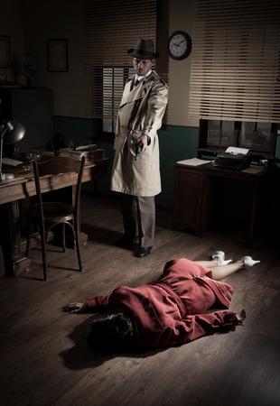Killer with gun next to a dead woman body lying on the floor, film noir scene. photo