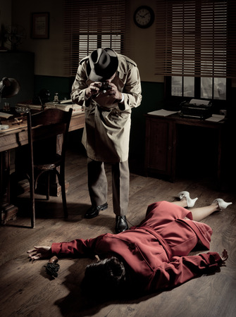 Photographer with vintage camera on crime scene with dead woman lying on the floor, film noir scene.