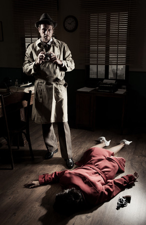 office force: Photographer with vintage camera on crime scene with dead woman lying on the floor, film noir scene.