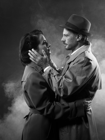 Film noir: romantic loving couple embracing in the dark, 1950s style Stock Photo